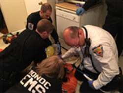 MD1 physicians and EMS working on a patient